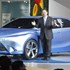 President Akio Toyoda unveils the prototype of a new hybrid car