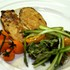 "Chef Malidis ""honey-glazed chicken breast with roast asparagus"" at SAA Business Class Lounge"